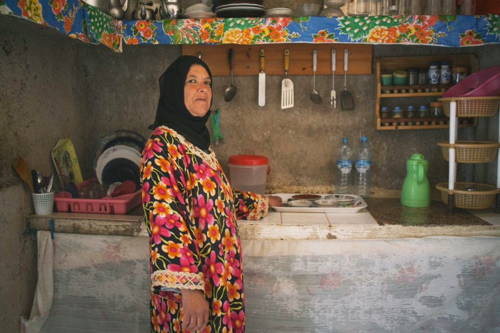 Fatna, 49, built her kitchen with money she inherited from her father when he died three years ago. It is one of four rooms in her house