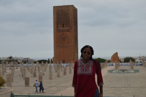 Maya poses in front of Tour Hassan II in Rabat, Morocco